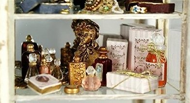 The Second Shelf Contains A Lovely Display Of Perfume And Toiletry Items.  Beautiful Crystal Perfume Bottles, As Well As Labeled Bottles Of Cologne,  Powder, ...