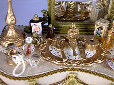 A Gold Dresser Set Includes Tray Mirror Brush Comb And Hair Receiver Trimmed With Filigree Work