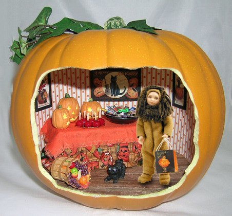 several years ago annie riepert and i colaborated on a halloween project i did the scene in the pumpkin and annie designed and created a darling lion
